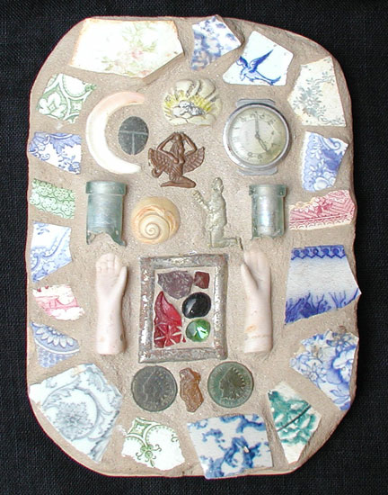 """Breastplate"" mosaic art. found objects, concrete, wood. 5"" x 8"""