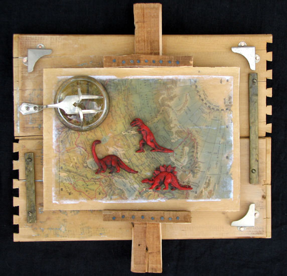 """Red Dinosaur Map"" assemblage sculpture. found objects, wood, adhesive, acrylic paint. 15 in x 15 in x 4 in."