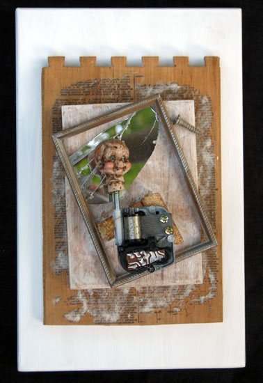 """Creepy Music Dolls Head"" assemblage sculpture. found objects, wood, adhesive, acrylic paint. 7.5 in x 11.75 in x 5 in."