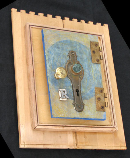 """Door Marked R"" assemblage sculpture. found objects, wood, adhesive, acrylic paint. 12 in x 15 in x 4 in."
