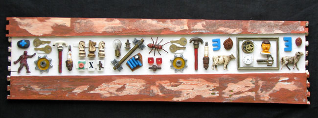 """Hieroglyphics with Clockmaker's Cartouche"" assemblage sculpture. found objects, wood, adhesive, acrylic paint. 31.5 in x 8.75 in x 2 in."