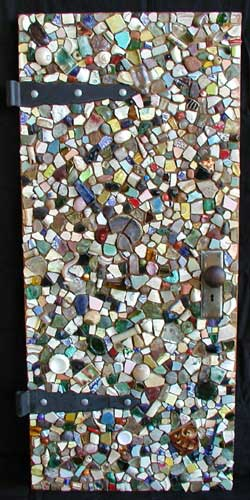 """Mosaic Door"" mosaic sculpture. ceramics, glass, porcelain and found objects on small oak door. 50"" x 22"""