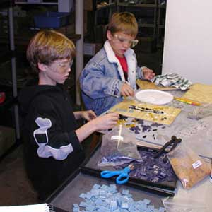 Making mosaics in the studio.