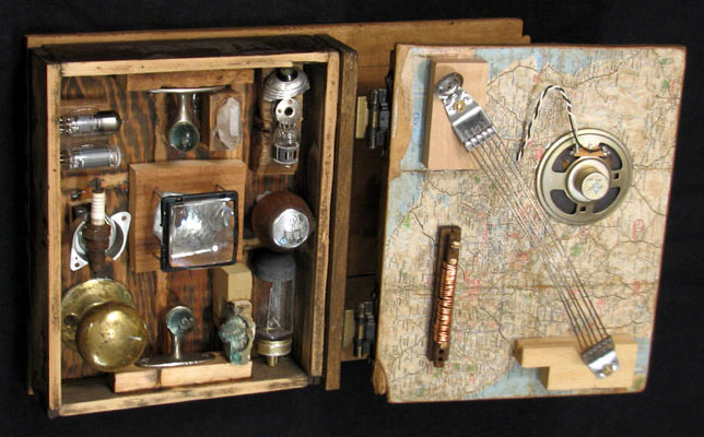 """Secret Transmitter"" found-object sculpture. found objects, wood, adhesive, acrylic paint. 11 in x 19 in x 8 in."